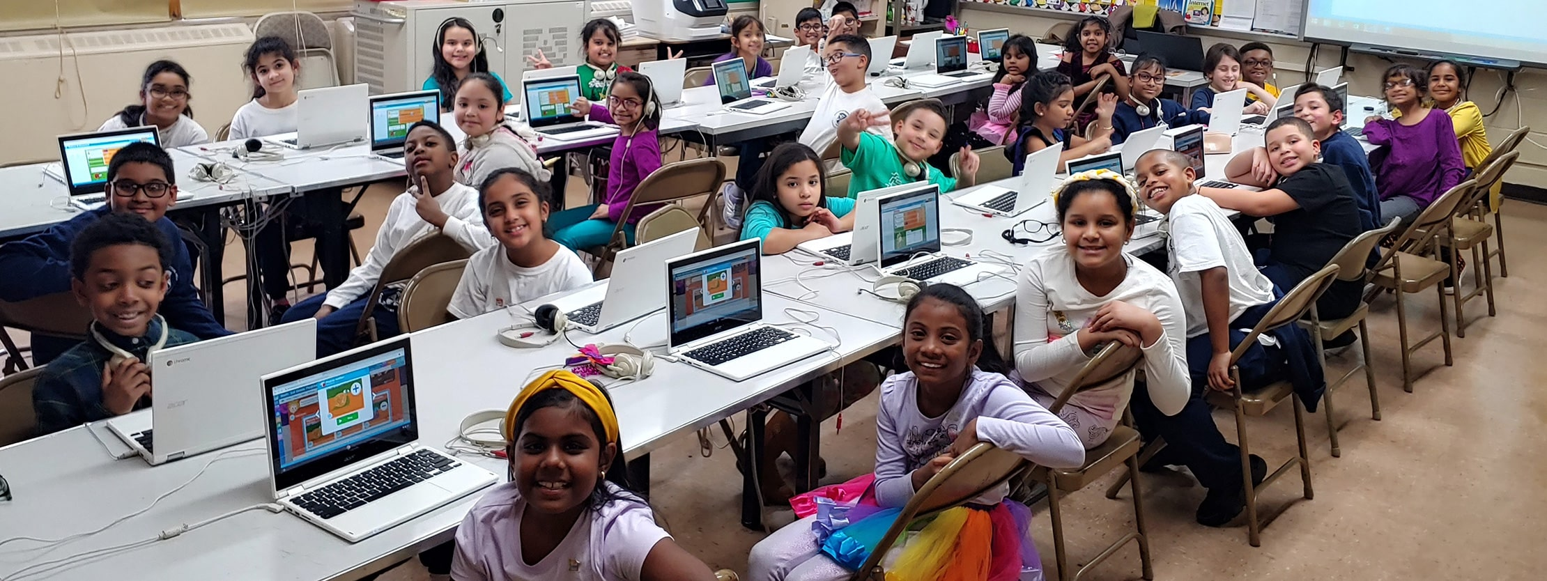 students smile for camera during open computer lab session